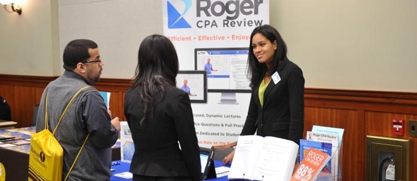 Roger CPA Review booth at networking event